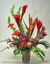 TA-1 Tropical flowers in a modern arrangement Flowers and colors may vary