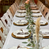 Table runner with stems in vases  wedding table decor