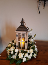 table wreath and lantern sympathy table arrangement