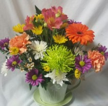 Teacup tin arrangement with mix Summer bright Flowers