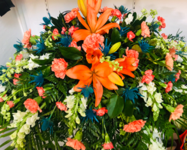 Teal and Orange Casket Flowers