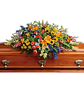 Teleflora's Colorful Reflections Casket Spray Sympathy in Auburndale, FL | The House of Flowers