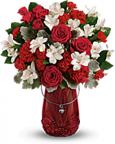 Teleflora's Red Haute Bouquet Mix arrangement in special vase