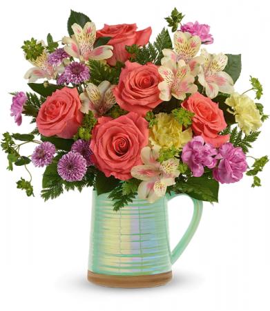Teleflora's Pour on the Beauty Pitcher Bouquet