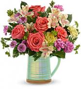 Teleflora's Pour on the Beauty vase