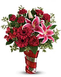 Teleflora's Swirling Desire Bouquet Mix arrangement in special vase