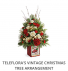 Teleflora's Vintage Christmas Tree Arrangement  Fresh arrangement in a collectible tin