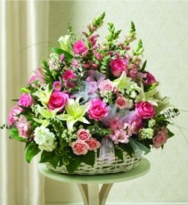 TENDER THOUGHTS ARRANGEMENT SEASONAL FLOWERS IN WICKER BASKET OF PINKS AND WHITES