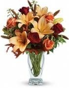 Th 4-Mixed flower arrangement in a vase Flowers and colors may vary