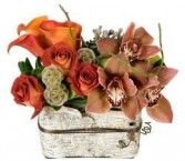 Th 7-Mixed flowers in a compact vase arrangement Flowers and colors may vary