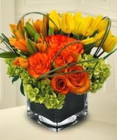 Th10- Mixed flowers in a compact vase arrangement Flowers and colors may vary