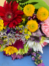 Bring a smile home ! wrapped mix flowers for pick up only