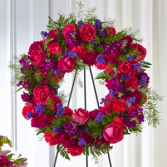The FTD Calming Colors Wreath Standing Spray