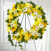 The FTD Golden Remembrance Wreath Standing Spray