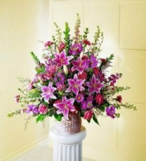 The FTD Leaf & Petals Basket Sympathy Arrangement