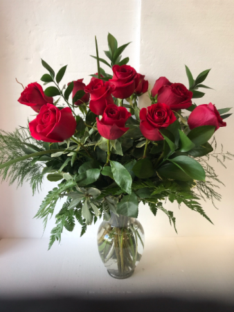 The Modern Dozen Twelve Long Stem Roses mixed as assortment of Fresh Greens