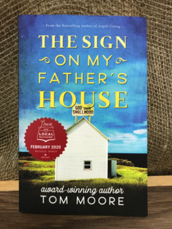 The sign on my father's house No book written by Tom Moore