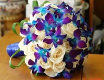 This Bouquet with blue orchids and white roses pricing determine the size of bouquet