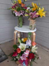 three different types of arrangements vase, basket,and ceramic