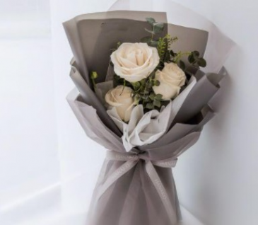 Three Long Stem Roses Wrapped HAND TIED BOUQUET