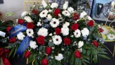 Touch of blue Red roses, white gerbera daisies, white carnations Monte cassino blue delphinium white roses