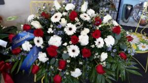 Touch of blue Red roses, white gerbera daisies, white carnations Monte cassino blue delphinium white roses in North Salem, IN | Garden Gate Gift & Flower Shop