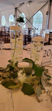 Triple candles with orchid and a floating candle  Centerpiece
