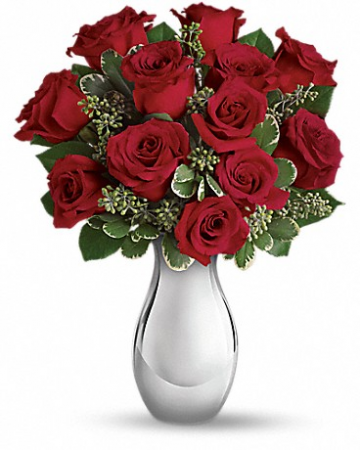 True Romance bouquet Turn up the heat on a new romance - or a lifelong love affair - with this classic composition. It features one dozen of our finest red roses arranged in our stunning Silver Reflections vase.