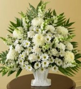 WHITE WONDER TRIBUTE All white flowers in a floral arrangement