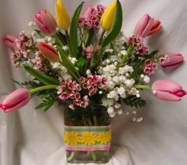 """TULIP GARDEN"" Mixed tulips with baby's breath arranged in a cute ribbon detailed vase!"