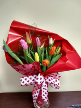 tulips wrapped in vase