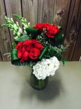 Twisted Love A twist on our premium dozen rose arrangement