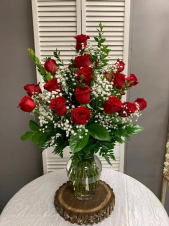 Two Dozen Red Roses Arranged With A Filler Flowers Vase Arrangement