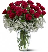 Two Dozen Red Roses Surrounded By Baby's Breath Vase