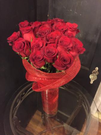 Two dozen roses in cylinder vase
