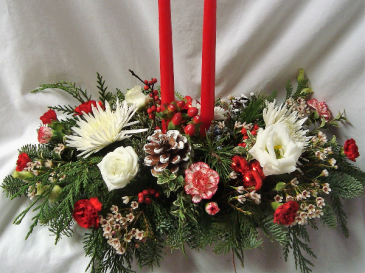 TWO RED OR WHITE CANDLE CHRISTMAS CENTERPIECE WITH RED AND WHITE FLOWERS, PINE CONES, CHRISTMAS GREENS, ETC.