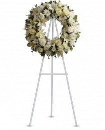 All  white sympathy  wreath. May or may not  need 1 day's notice.