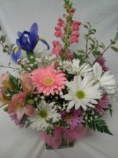 Soft colors of pinks, lavenders, whites and blues  arranged in a vase!