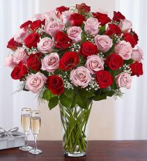 Ultimate Elegance™ Long Stem Pink & Red Roses All-around arrangement