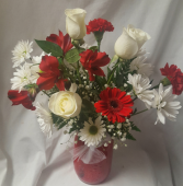 RED MASON JAR with red and white seasonal  flowers...roses, daisies, altra lilies, baby's breath, gerbera daisy. (Substitution if some flowers are not available)