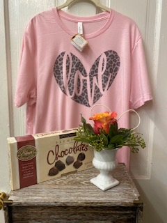 Valentine Bundle Includes a single rose bud vase, box of chocolate, and a trendy shirt.