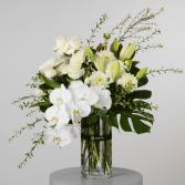 vase, white orchid, roses, amaryllis centerpiece
