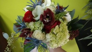 Very Unique , But Stunning !!!! A Bouquet done with Star Of Bethlehem , Blue Thistle , Green Hydrangeas , Deep Red Cymbid Orchids  , White Cala Lily  in Paradise, NL | PARADISE FLOWERS & GIFTS