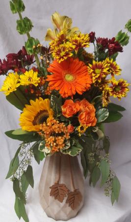 Elegant Autumn vase with dangling leather leaves Arranged with bright seasonal flowers...great keepsake vase