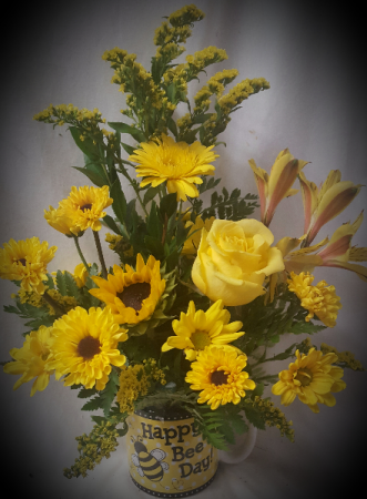 """FRIEND FOREVER BOUQUET""Yellow seasonal flowers  ARRANGED in a cute HAPPY BEE DAY MUG!"