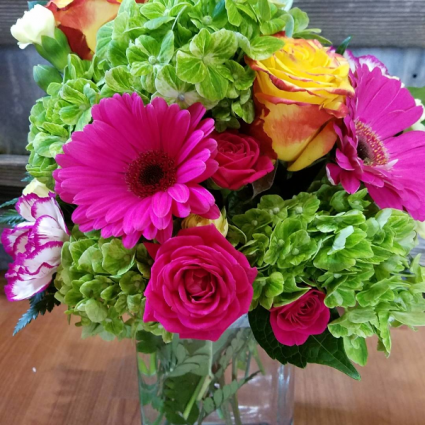 Vibrant Hues vase with green hydrangea, hot pink gerbs, yellow roses