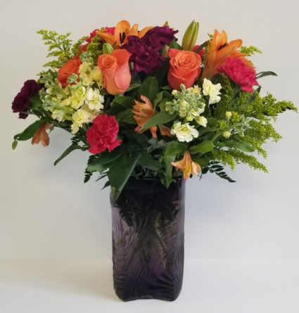 Vibrant Medley  In A Purple Vase
