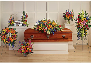 Vibrant Memories Funeral Setting Casket Spray + Accent Pieces in Henderson, TX | RAYFORD FLORIST & GIFTS