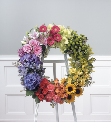 "RAINBOW CIRCLE OF LIFE 30"" WREATH ON A 6' STAND"