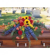 Vibrant Summer Casket Spray Funeral Arrangement